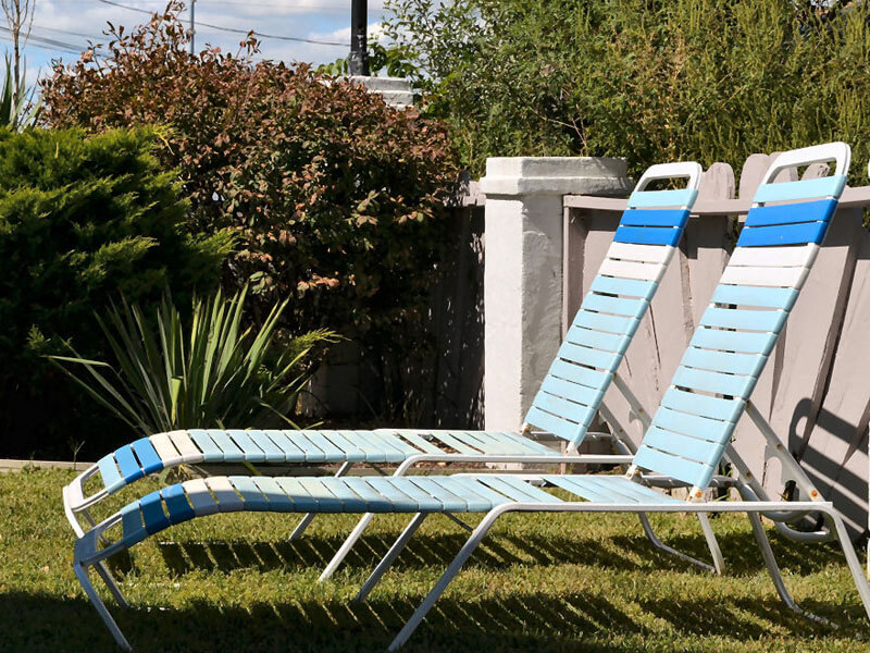 AO - Pool chairs on green grass